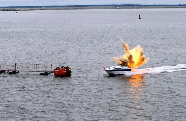 Explosives aboard a small boat are detonated to convey the reality of a small boat terrorist attack during Citadel Protect 2010. Citadel Protect is a series of training exercises to assess the Navy's capability to protect waterborne assets against threats in Navy ports. Citadel Protect is a coordinated event between U.S. Fleet Forces and Commander, Navy Installations Command.