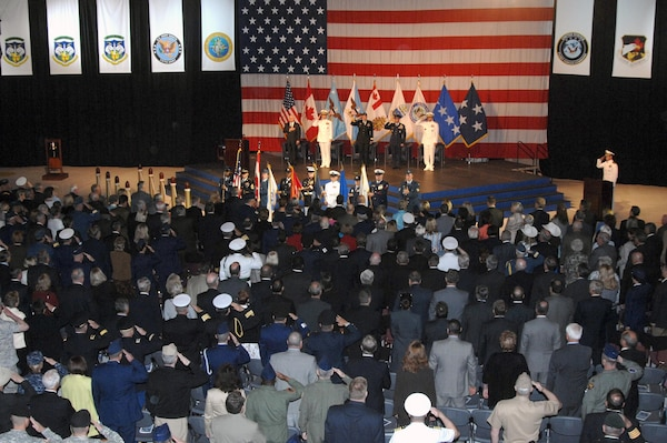 Members of the audience salute as the Canadian and U.S. national anthems are played at the North American Aerospace Defense Command and U.S. Northern Command change of command ceremony at Peterson Air Force Base, Colo., May 19. Navy Adm. James Winnefeld assumed leadership of the commands from Air Force Gen. Gene Renuart.