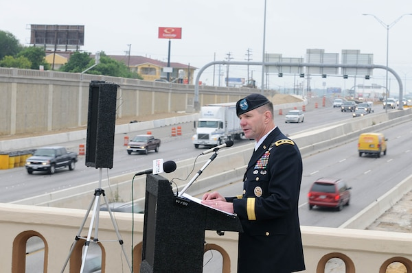"Army Maj. Gen. Perry Wiggins, deputy commanding general, Army North and Fort Sam Houston, thanks city and state government representatives for their support on the construction of the bridge over Interstate Highway 35 during the Texas Department of Transportation's Walters Street Bridge Ribbon Cutting Ceremony May 25 to officially open the ""New Gateway to Fort Sam Houston."""