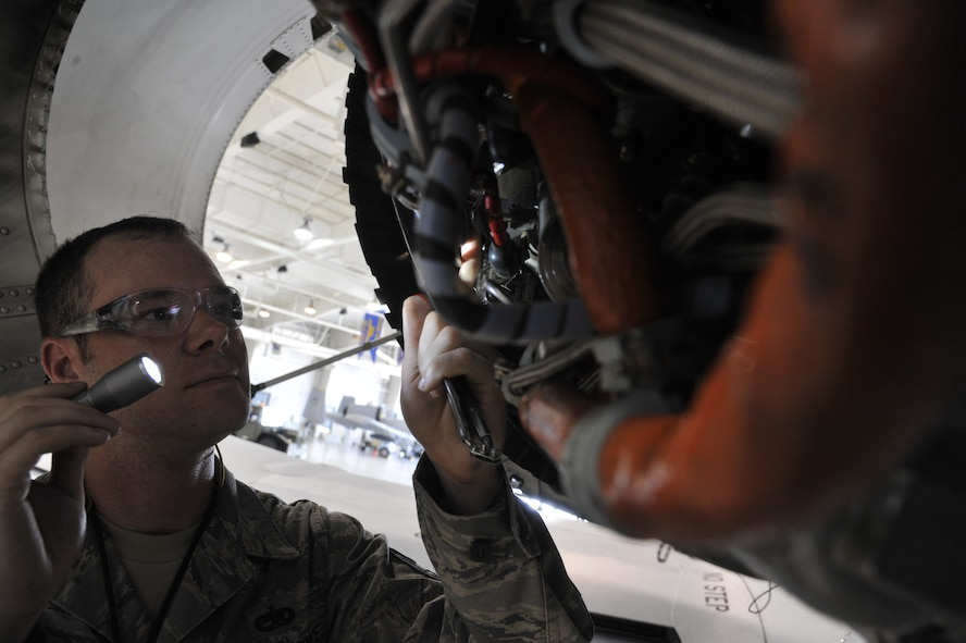 Tech. Sgt. Michael Schuler, 442nd Maintenance Squadron phase dock technician, inspects clamps on electrical and hydraulic line hoses on an A-10 Thunderbolt II engine at Whiteman Air Force Base, Mo., June 11, 2013.  This inspection ensures proper alignment and spacing between wires. (U.S. Air Force photo by Airman 1st Class Keenan Berry/Released)