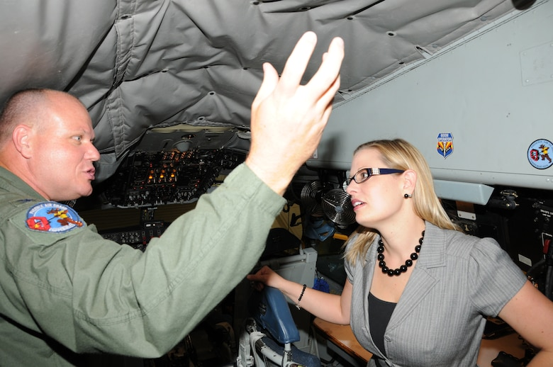 U.S. Air Force Colonel Gary Brewer, 161st Air Refueling Wing Commander, conducts a tour of the KC-135R Stratotanker to Congresswoman Kyrsten Sinema at Phoenix Sky Harbor Air National Guard Base, July 1, 2013. Congresswoman Sinema was the guest speaker at the Sky Harbor Squadron 301, Arizona Wing Civil Air Patrol July assembly held in the 161st Air Refueling Wing Dining Facility. (U.S. Air National Guard photo by Master Sgt. Kelly M. Deitloff/Released