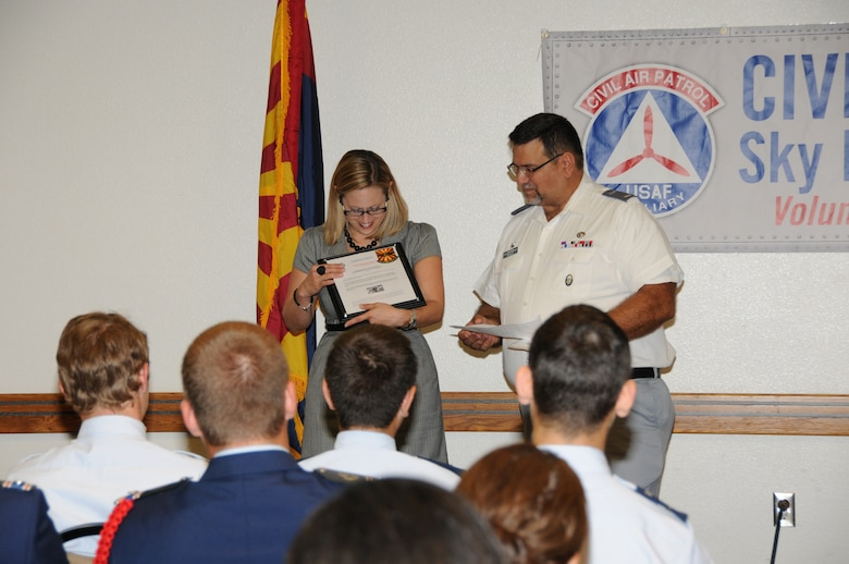 Civil Air Patrol 2LT Moseley presents Congresswoman Kyrsten Sinema with the Ruth Nichols Award of Appreciation at the 161st Air Refueling Wing July 1, 2013.  They award was presented to the Congresswoman for her support of the Sky Harbor Squadron 301, Arizona Wing Civil Air Patrol unit. (U.S. Air National Guard photo by Master Sgt. Kelly M. Deitloff/Released)