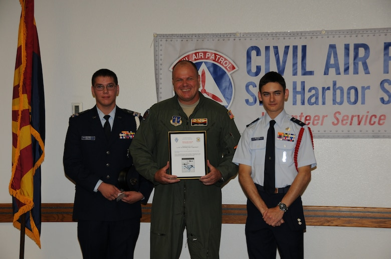 Civil Air Patrol cadets Smalley and Lacy present Colonel Gary Brewer, 161st Air Refueling Wing Commander, with the Wesley May Award of Appreciation at Phoenix Sky Harbor Air National Guard Base July 1, 2013.  The award was presented for extraordinary services to Sky Harbor Squadron 301, Arizona Wing Civil Air Patrol. (U.S. Air National Guard photo by Master Sgt. Kelly M. Deitloff/Released)