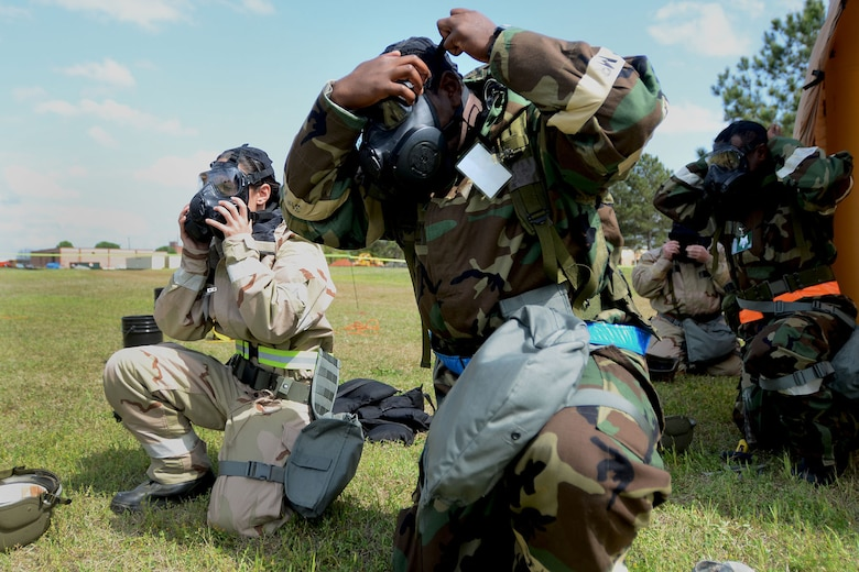 U.S. Air Force Airmen with the 169th Fighter Wing at McEntire Joint National Guard Base, S.C., don their gas masks in response to a simulated chemical attack during a Readiness Exercise, April 12, 2013. Members of the 169th Fighter Wing are preparing for a Phase I and II Readiness Inspection, which evaluates a unit's ability to deploy, then operate and launch missions in a chemical combat environment.  (U.S. Air National Guard photo by Tech. Sgt. Caycee Watson/Released)