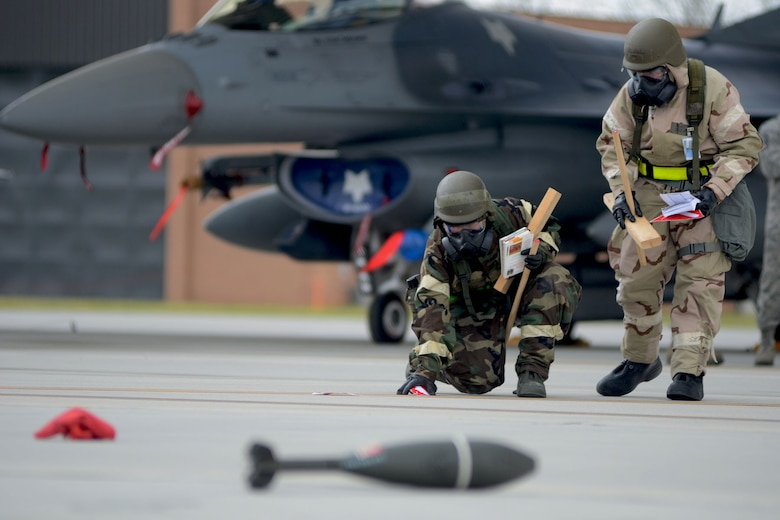 U.S. Air Force Airmen, assigned to a Post Attack Reconnaissance team for the 169th Fighter Wing at McEntire Joint National Guard Base, S.C., conduct PAR checks after a simulated chemical attack on the flight line during a Phase II Readiness Exercise, April 12, 2013. Members of the 169th Fighter Wing are preparing for a Phase I and II Readiness Inspection, which evaluates a unit's ability to deploy, then operate and launch missions in a chemical combat environment.   (U.S. Air National Guard photo by Tech. Sgt. Caycee Watson/Released)
