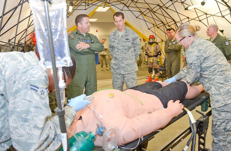 Maj. Stephen Baffic, Homeland Response Force surgeon with the 116th Air Control Wing, briefs Lt. Gen. Stanley E. Clarke III, director of the Air National Guard, during a hands-on demonstration by the 116th Medical Group's Chemical, Biological, Radiological, Nuclear and Explosives Enhanced Response Force unit during Clarkes orientation visit to the JSTARS unit at Robins Air Force Base, Ga., July 3, 2013.  The visit is Clarke's first to Team JSTARS since becoming director of the Air National Guard.  During the visit Clarke received a mission orientation, toured the E-8C and visited Airmen and Soldiers throughout the unit. (U.S. Air National Guard photo by Master Sgt. Roger Parsons/Released)
