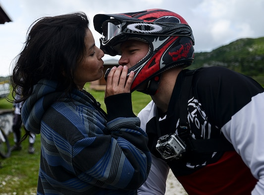 Leticia Mace kisses her husband, Staff Sgt. Alex Mace, before he rides his mountain bike down a trail in Piancavallo, Italy, June 30, 2013. Sergeant Mace suffered a near-fatal mountain biking accident on that same trail June 24, 2012. He is assigned to the 31st Fighter Wing Safety Office. (U.S. Air Force photo/Staff Sgt. Katherine Tereyama)