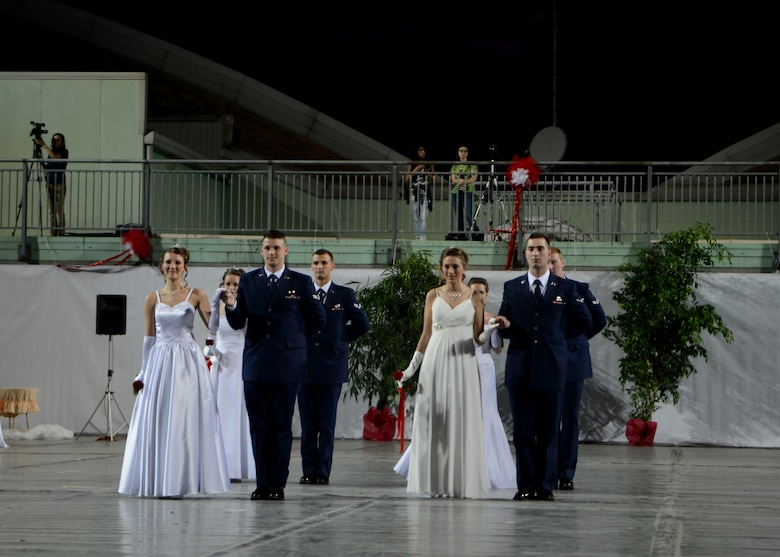 (From left) Airman 1st Class Joshua Blackburn and Airman Ryan Conroy present their debutants during the 15th edition of Ballo delle Debuttanti June 30, 2013, in Cordenons, Italy. The ball hosted 38 debutants that were accompanied by members from the 31st Fighter Wing, the 132nd Brigata corazzata (armored brigade) and other local Italians. (U.S. Air Force photo/Staff Sgt. Evelyn Chavez)