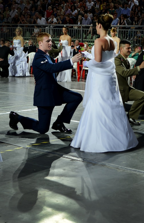 Airman 1st Class Matthew Lotz presents a rose to Alice Bertolin during the 15th edition of Ballo delle Debuttanti June 30, 2013, in Cordenons, Italy. The dance is a tradition dating back to the 1800s that introduces women into society when they are considered mature enough, typically by 17 to 18 years of age. (U.S. Air Force photo/Staff Sgt. Evelyn Chavez)