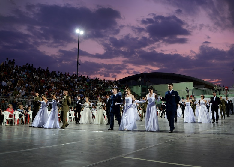 Participants present themselves during the 15th edition of Ballo delle Debuttanti June 30, 2013, in Cordenons, Italy. The ball hosted 38 debutants that were accompanied by members from the 31st Fighter Wing, the 132nd Brigata corazzata (Italian Army) and other local Italians. (U.S. Air Force photo/Staff Sgt. Evelyn Chavez)