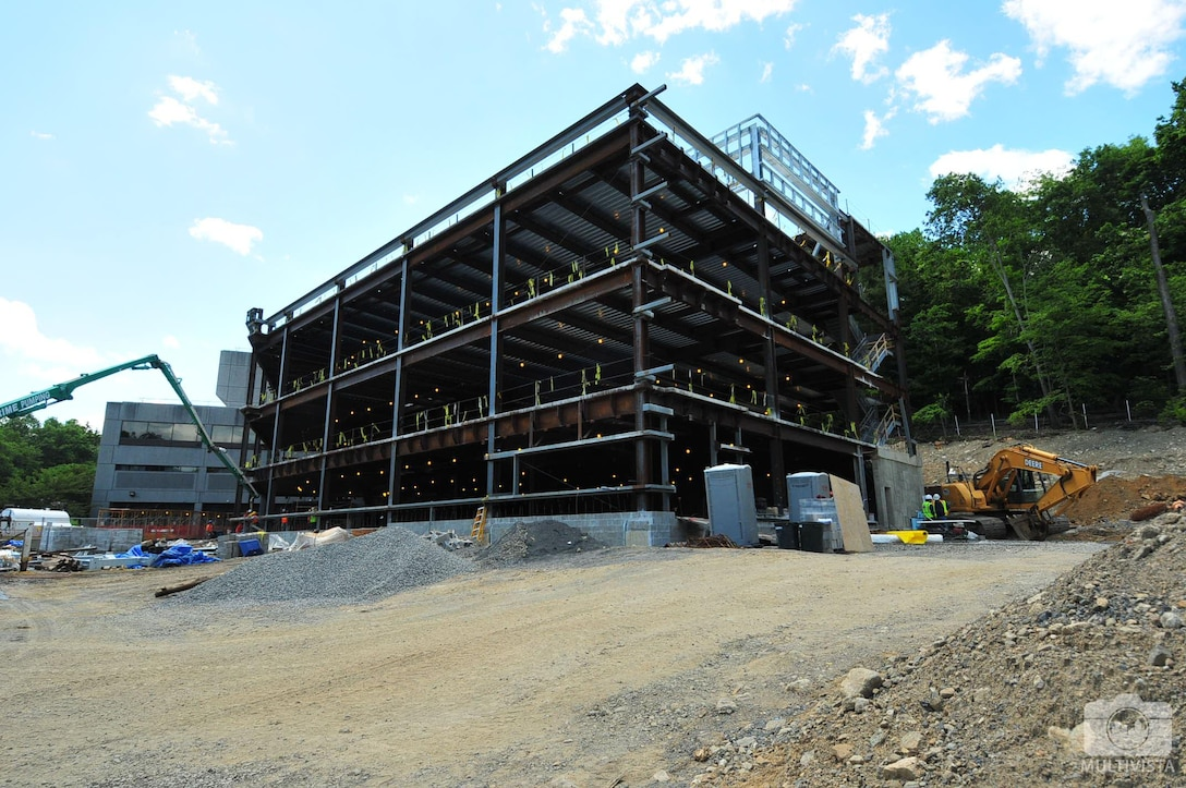 Progress being made on the Clinic Addition project with the existing hospital in the background.
