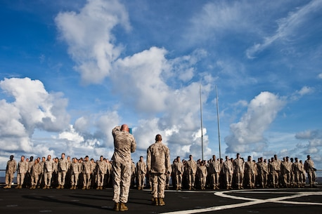 Sergeant Maj. William J. Grither, sergeant major of Combat Logistics Battalion 31, 31st Marine Expeditionary Unit, reads a promotion warrant to a formation of Marines during a promotion ceremony here, July 1. This month, four CLB Marines  aboard USS Germantown were promoted to various ranks from lance corporal to sergeant. The 31st MEU is the only continuously forward-deployed MEU and is the Marine Corps' force in readiness in the Asia-Pacific region.