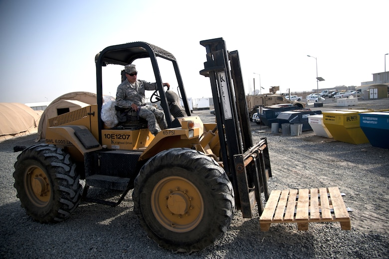 U.S. Air Force Airman 1st Class Mickey Laskowsky, 380th Expeditionary Force Support Squadron food services technician, drives his all-terrain 6K forklift to get more pallets of water for delivery at an undisclosed location in Southwest Asia July 3, 2013. Laskowsky is the main forklift operator for the 380th EFSS where he uses it to deliver water to 58 different stops a day. He is originally from Pittsburgh, Penn., and is stationed with the 171st Air Refueling Wing with the Pennsylvania Air National Guard. (U.S. Air Force photo by Senior Airman Jacob Morgan)