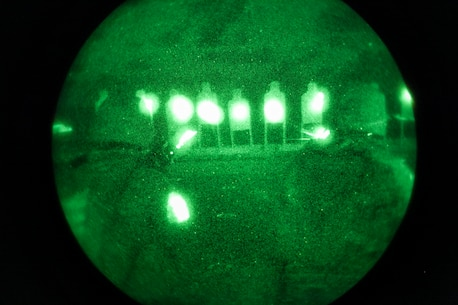 Marines with Company E., Battalion Landing Team 2nd Battalion, 4th Marines, 31st Marine Expeditionary Unit, take aim on silhouette targets using rail-mounted laser sights during close quarters, low-light combat marksmanship training from the flight deck here, July 5. More than 100 Marines of the company were able to test their night-time marksmanship on the flight deck, expending thousands of rounds of ammunition over a period of three hours. The 31st MEU is the Marine Corps' force in readiness for the Asia Pacific region and the only continuously forward-deployed MEU.