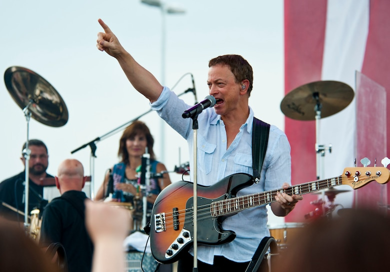 YOKOTA AIR BASE, Japan – Actor Gary Sinise greets the crowd at Yokota Air Base, Japan, July 4, 2013.  Sinise and his Lt. Dan Band held a show for the armed service members and their family at Yokota.  (U.S. Air Force photo by Airman 1st Class Soo C. Kim)