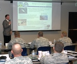 Bob Reininger, North American Aerospace Defense Command and U.S. Northern Command Interagency Coordination office, speaks to more than 50 National Guard officers during the Joint Task Force Commander Training Course June 14. the course is designed to prepare potential joint task force commanders to coordinate active-duty, National Guard and federal civilian agencies during a crisis.