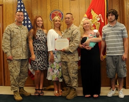 Col. David Maxwell, left, poses with Master Sgt. Anthony Forbes and his family after Forbes re-enlistment ceremony July 3, 2013, on Marine Corps Base Quantico. Forbes has been serving as a Marine for almost 25 years.