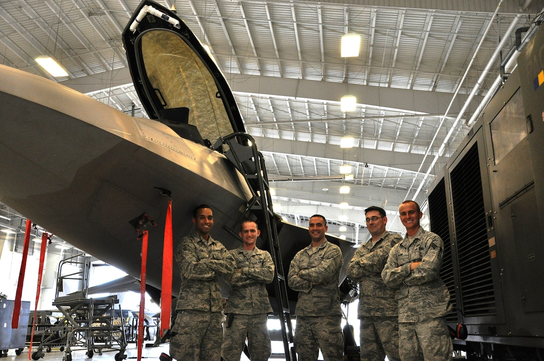 Capt. Stephen Rose, 43rd Aircraft Maintenance Unit officer in charge; Tech. Sgt. Kraig Callais, 43rd AMU avionics fleet health manager; Senior Airman Christopher Dunn, 43rd AMU F-22 specialist; Airman 1st Class Kenan Harvey, 43rd AMU F-22 specialist; and Airman 1st Class Daniel Ramize, 43rd AMU F-22 specialist, pose in front of an F-22 Raptor that they are currently working on inside the hangar of the 43rd AMU at Tyndall Air Force Base. The Avionics Health of the Fleet program was implemented to increase the number of fully mission capable F-22s on Tyndall's flight line. (U.S. Air Force photo by Airman 1st Class Alex Echols)