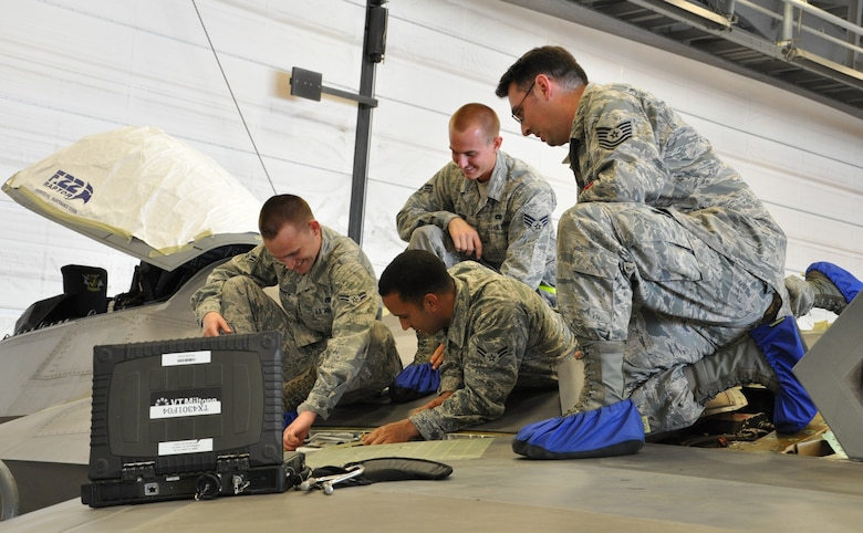 Tech. Sgt. Kraig Callais, 43rd Aircraft Maintenance Unit avionics fleet health manager, Senior Airman Christopher Dunn, 43rd AMU F-22 specialist, Airman 1st Class Kenan Harvey, 43rd AMU F-22 specialist and Airman 1st Class Daniel Ramize, 43rd AMU F-22 specialist, address an issue on top of an F-22 Raptor as part of the Avionics Health of the Fleet inside the hangar of the 43rd AMU at Tyndall Air Force Base, Fla. AVHOF is a program implemented to increase the number of fully mission capable F-22s on Tyndall's flight line. (U.S. Air Force photo by Airman 1st Class Alex Echols)