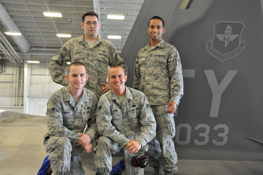 Tech. Sgt. Kraig Callais, 43rd Aircraft Maintenance Unit avionics fleet health manager; Senior Airman Christopher Dunn, 43rd AMU F-22 specialist; Airman 1st Class Kenan Harvey, 43rd AMU F-22 specialist; and Airman 1st Class Daniel Ramize, 43rd AMU F-22 specialist, pose on top of an F-22 Raptor that they are currently working on inside the hangar of the 43rd AMU at Tyndall Air Force Base, Fla. This is part of the Avionics Health of the Fleet program, which was implemented to increase the number of fully mission capable F-22s on Tyndall's flight line. (U.S. Air Force photo by Airman 1st Class Alex Echols)