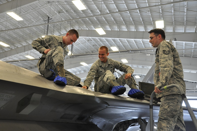 Tech. Sgt. Kraig Callais, 43rd Aircraft Maintenance Unit avionics fleet health manager; Senior Airman Christopher Dunn, 43rd AMU F-22 specialist; and Airman 1st Class Kenan Harvey, 43rd AMU F-22 specialist, address an issue of an F-22 Raptor as part of Avionics Health of the Fleet inside the hangar of the 43rd AMU at Tyndall Air Force Base, Fla. AVHOF is a program implemented to increase the number of fully mission capable F-22s on Tyndall's flight line. (U.S. Air Force photo by Airman 1st Class Alex Echols)