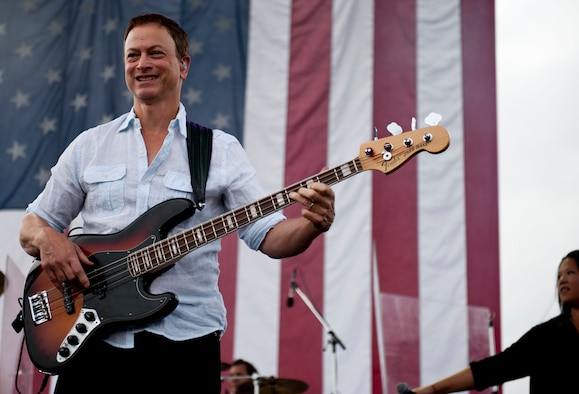 YOKOTA AIR BASE, Japan -- Actor Gary Sinise, a member of the Lt. Dan Band, plays for the audience on July 4, 2013 at Yokota Air Base, Japan.  Following the concert a fireworks display ended the annual Celebrate America day hosted by the installation. (U.S. Air Force photo by Airman First Class Meagan Schutter)