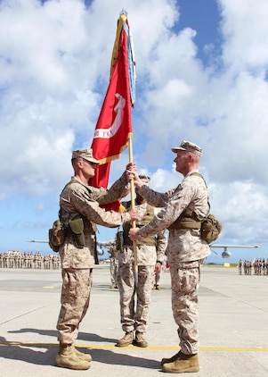 Maj. Gen. Christopher S. Owens, right, passes the 1st Marine Aircraft Wing colors to Brig. Gen. Steven R. Rudder July 9 during the 1st MAW change of command ceremony at Marine Corps Air Station Futenma. Owens will become the commanding general of U.S. Marine Forces Korea and the assistant chief of staff, C/J-5 plans, policy and strategy, United Nations Command, Combined Forces Command, U.S. Forces Korea. Rudder's previous assignment was at Headquarters Marine Corps where he served as the legislative assistant to the commandant of the Marine Corps. 1st MAW is part of III Marine Expeditionary Force. (U.S. Marine Corps photo by Lance Cpl. Donald T. Peterson/Released)