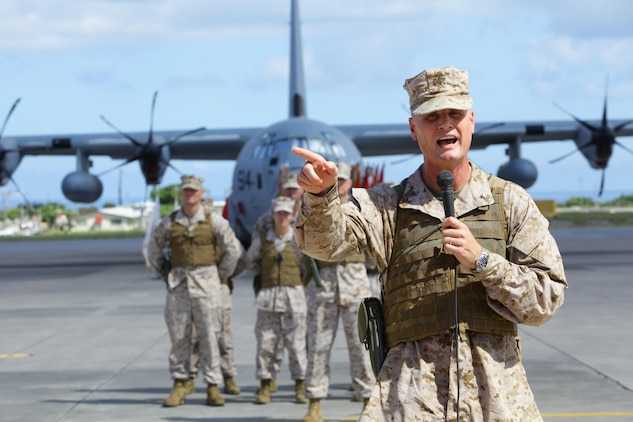 """Brig. Gen. Steven R. Rudder expressed his intent to build upon 1st Marine Aircraft Wing's past successes during the 1st MAW change of command ceremony July 9 at Marine Corps Air Station Futenma. """"When the commandant and the other general officers back in D.C. talk about this MAW, they talk about all the great things that have been accomplished…and I intend to continue leading this MAW to greatness,"""" said Rudder. Rudder relieved Maj. Gen. Christopher S. Owens as commanding general of 1st MAW, III Marine Expeditionary Force. (U.S. Marine Corps photo by Lance Cpl. Natalie M. Rostran/Released)"""
