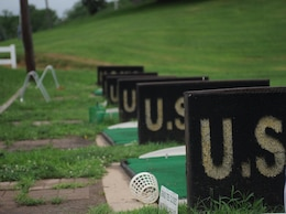 Barriers section off the golfers so that they can safely practice their swings athe driving range at the Medal of Honor Golf Course aboard Marine Corps Base Quantico on July 3, 2013. The golf course is a traditional 18-hole course.