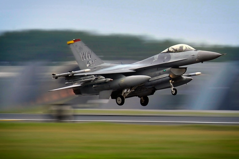 An F-16 Fighting Falcon from the 35th Fighter Wing takes off at Misawa Air Base, Japan, June 28, 2013. Pilots from the 35th Fighter Wing flew to Draughon Range to test their efficiency on engaging ground targets. (U.S. Air Force photo by Staff Sgt. Nathan Lipscomb)