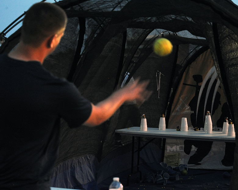 U.S. Air Force Senior Airman Jeffery Jordan, 755th Aircraft Maintenance Squadron, throws a ball at one of the booths at the Independence Day Celebration at Davis-Monthan Air Force Base, Ariz., July 4, 2013. The event had several booths and games to entertain members of the Desert Lightning Team. (U.S. Air Force photo by Senior Airman Timothy Moore/Released)