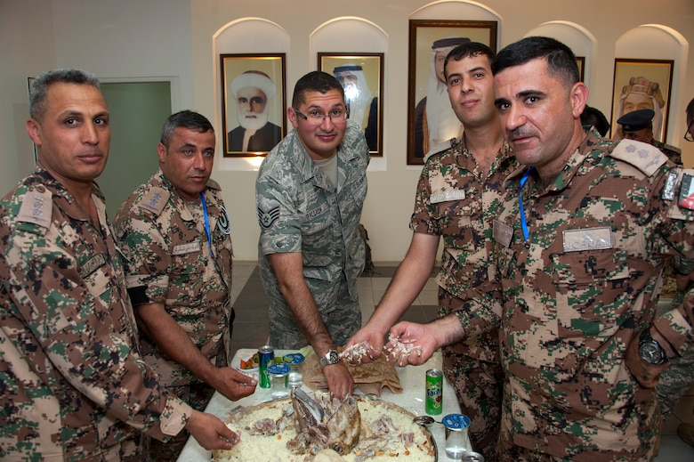 As part of the opening ceremonies of an Eager Lion event, members from the Royal Jordanian Air Force share a traditional meal of mansaf with Staff Sgt. Erik Gallion (pictured) as well as others from the Colorado Air National Guard. Eager Lion is a U.S. Central Command-directed, irregular warfare-themed exercise focusing on missions the United States and its coalition partners might perform in support of global contingency operations. (U.S. Air National Guard photo by Senior Master Sgt. John P. Rohrer)