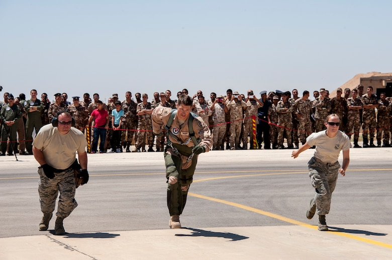 Capt.James Edwards, a pilot with the 120th Fighter Squadron, and his crew chiefs Tech Sgt. Joshua Matthews and Senior Airman Kristen Lee, run to launch an F-16 Fighting Falcon as part of a scramble competition event between the Colorado Air National Guard and the Royal Jordanian Air Force. The Scramble tests the pilots and their crew chiefs in their ability to launch aircraft in a simulated quick response scenario during Eager Lion. Eager Lion is a U.S. Central Command-directed, irregular warfare-themed exercise focusing on missions the United States and its coalition partners might perform in support of global contingency operations. (U.S. Air National Guard Photo by Senior Master Sgt. John P. Rohrer)