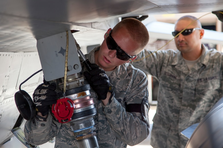 Senior Airman Brandon Olson from the 140th Wing, Colorado Air National Guard, fuels an F-16 aircraft located at a training base in Northern Jordan as part of Exercise Eager Lion. Eager Lion is a U.S. Central Command-directed, irregular warfare-themed exercise focusing on missions the United States and its coalition partners might perform in support of global contingency operations. (U.S. Air National Guard photo by Senior Master Sgt. John P. Rohrer)