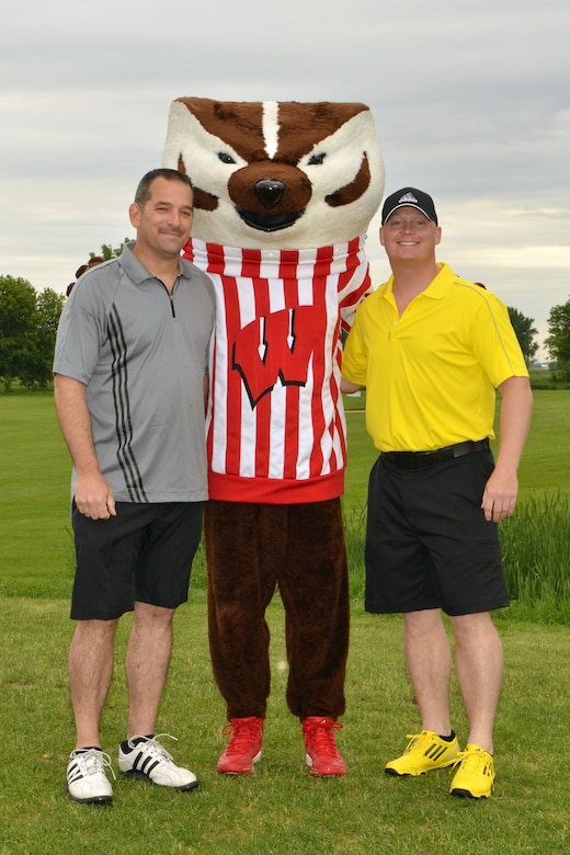 115th Fighter Wing members Darin Trautner, left, and Brandon Lutz, take a moment to pose with University of Wisconsin mascot Bucky Badger prior to the start of the 2013 Falcon Open charity golf tournament at Bridges Golf Course in Madison, Wis. June 7. Proceeds from the event raised over $7000 to assist local Air National Guard Airmen and their families in times of need.