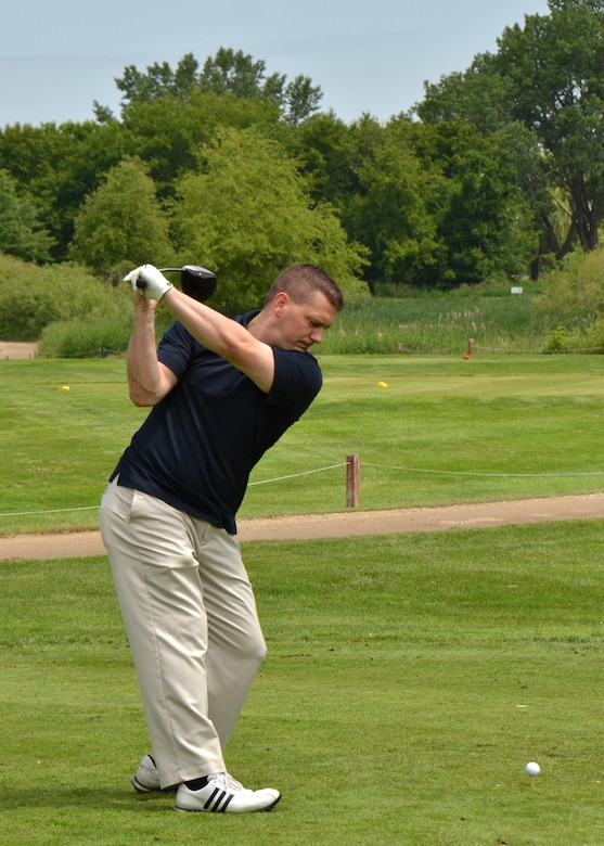 115th Fighter Wing budget analyst Joshua Johnson tees off for the 2013 Falcon Open charity golf tournament at Bridges Golf Course in Madison, Wis. June 7. Proceeds from the event raised over $7000 to assist local Air National Guard Airmen and their families in times of need.
