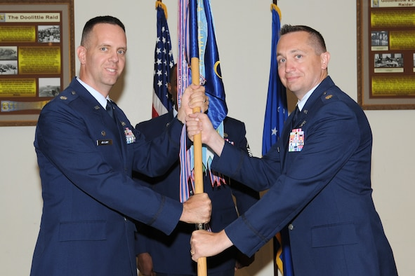 GOODFELLOW AIR FORCE BASE, Texas -- Lt. Col. Jeffrey McBride, 17th Mission Support Group Commander, passes the 17th Communications Squadron guidon to the incoming commander, Maj. Ryan Vetter, during the Change of Command ceremony, July 3. The change of command ceremony is steeped in tradition and allows units to witness the formal command transfer from one officer to another.  (U.S. Air Force photo by Staff Sgt. Laura R. McFarlane)