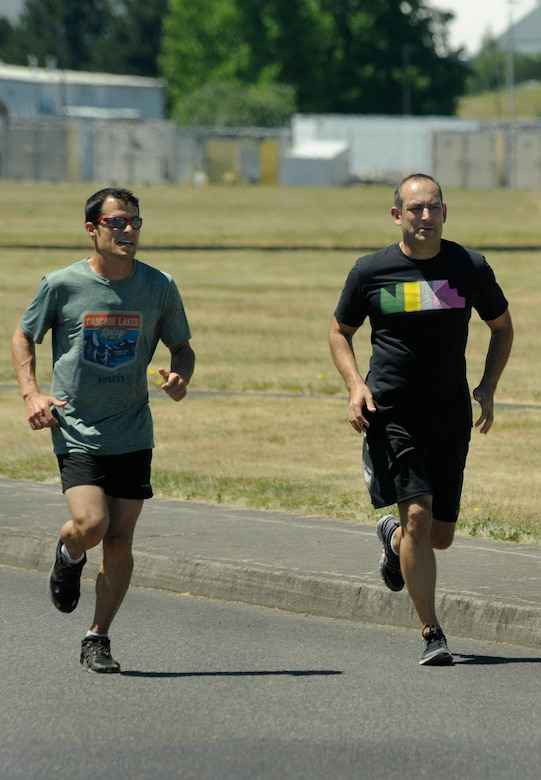 Oregon Air National Guard Col. Matthew Schuster, (right) Vice Commander, 142nd Fighter Wing and Executive Officer Maj. Frank Page (left) take off for an afternoon run at the Portland Air National Guard Base, Portland, Ore., July 3, 2013. Schuster's workout routine helps him maintain a high level of fitness as an F-15 Eagle pilot for the Oregon Air National Guard. (Air National Guard Photo by Tech. Sgt. John Hughel, 142nd Fighter Wing Public Affairs/released)