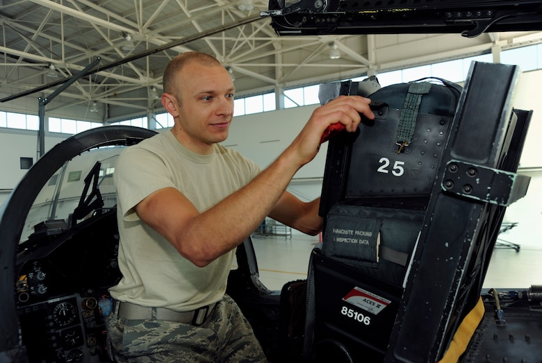 Oregon Air National Guard Staff Sgt. Dwayne Farr, an Egress repairman with the 142nd Fighter Wing inspects an F-15 Eagle seat at the Portland Air National Guard Base, Portland, Ore., July 9, 2013. (Air National Guard Photo by Tech. Sgt. John Hughel, 142nd Fighter Wing Public Affairs/released)