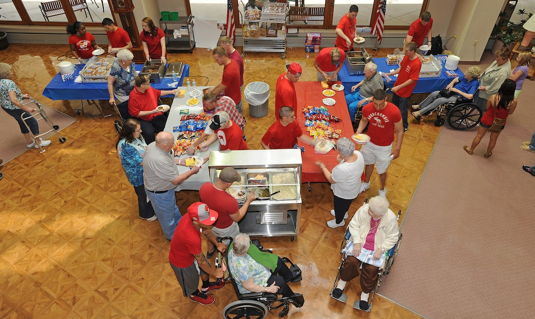 Members of Friends of Veterans volunteer organization served lunch to residents of Trinity Homes in Minot, N.D., June 28. The event is part of the group's efforts to maintain the bond between veterans and active military members. (U.S. Air Force photo/Senior Airman Jose L. Hernandez)