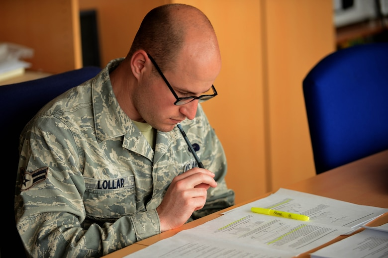 SPANGDAHLEM AIR BASE, Germany – U.S. Air Force Airman 1st Class Alex Lollar, a 606th Air Control Squadron radio frequencies transmissions systems technician from Pensacola Fla., studies his career development course material June 26, 2013. Lollar supports the 606th ACS by troubleshooting and understanding how to operate radios. (U.S. Air Force photo by Airman 1st Class Kyle Gese/Released)