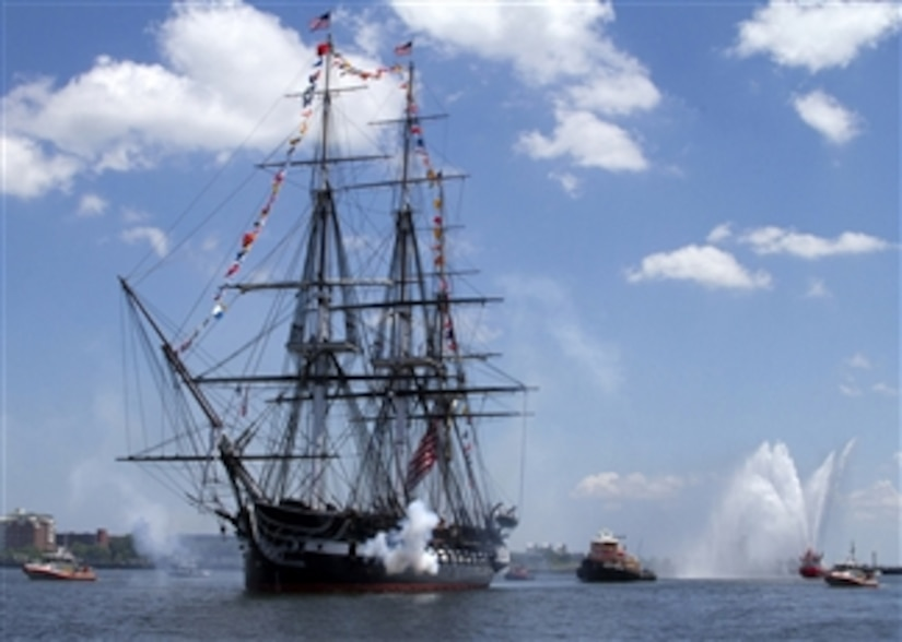The USS Constitution fires a 21-gun salute in honor of America's 237th birthday during the ship's annual Fourth of July turnaround cruise in Boston Harbor on July 4, 2013.  More than 500 guests got underway with Old Ironsides for a three-hour tour of Boston Harbor in celebration of Independence Day.