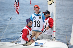 Skipper - Navy ENS Taylor Vann (center) with crew Navy LCDR Luke Suber (left) and Coast Guard LTJG Jonathan Duffett finish the final leg of race 17 at the 2013 CISM Sailing World Military Championship in Bergen, Norway 27 June to 4 July.