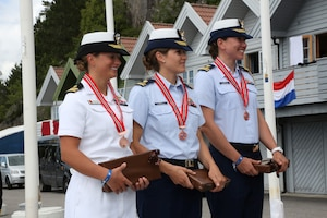 Navy LT Trisha Kutkiewicz, Coast Guard LTJG Krysta Rohde and Coast Guard LT Elizabeth Tufts of the US Armed Forces Womens Sailing Team win the bronze medal of the CISM World Sailing Military Championship in Bergen, Norway 27 June to 4 July 2013.