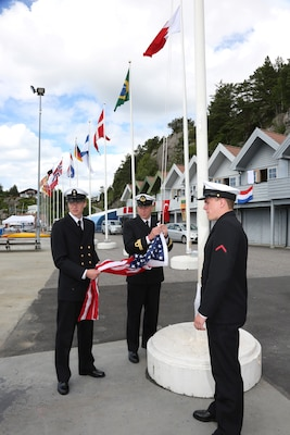 Sailors of the Norwegian Navy prepare to raise the US Flag during the awards ceremony of the 2013 CISM Sailing World Military Championship in Bergen, Norway 27 June to 4 July. Team USA Women won the bronze medal led by Skipper Navy LT Trisha Kutkiewicz with Coast Guard LTJG Krysta Rohde and Coast Guard LT Elizabeth Tufts.