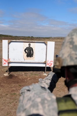 A U.S. Army North Soldier fires an M-9 Berretta Pistol during advanced marksmanship training conducted by Army North's Headquarters Support Company Jan. 20 at the Camp Bullis Military Training Reservation in San Antonio.
