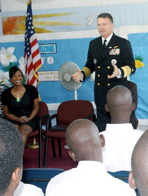 Adm. James Winnefeld, NORAD and USNORTHCOM commander, speaks to students at the Simpson Penn Centre for Boys during a visit to the Bahamas Feb. 9. At the conclusion of the event USNORTHCOM donated $3000 worth of sporting goods to the center to encourage the young men to pursue positive recreational activities and a healthy lifestyle. Winnefeld's visit to Simpson Penn was part of a two-day visit by a USNORTHCOM delegation to discuss ongoing bilateral efforts to improve security in the region.