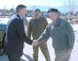 Colorado Governor John Hickenlooper shakes hands with Army Lt. Gen. Frank Grass, U.S. Northern Command deputy commander, and Canadian Lt.-Gen. Marcel Duval, North American Aerospace Defense Command deputy commander, at the beginning of a visit to NORAD and USNORTHCOM headquarters on Peterson Air Force Base, Colo., Feb. 10. Hickenlooper received a briefing outlining the missions of the commands and a tour of the NORAD and USNORTHCOM Command Center.