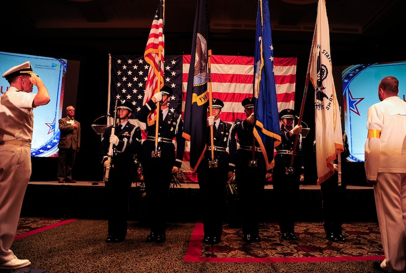 Members of the Joint Base Charleston Honor Guard present the colors during the Salute to the Military ceremony June 27, 2013, at the North Charleston Performing Arts Center, North Charleston, S.C. The Charleston Metro Chamber of Commerce presented awards to military members who volunteered a significant amount of their time in the community. The awards included the Enlisted Active-Duty Service Person of the Year, Enlisted Reservist of the Year and the Civilian Employee of the Year. (U.S. Air Force photo/Staff Sgt. Rasheen Douglas)