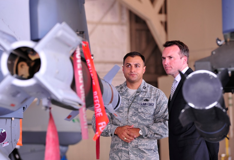 LAS VEGAS, Nev. -- Acting Secretary of the Air Force Eric Fanning receives a brief on the weapon capabilities of the MQ-9 Reaper aircraft from Capt. Joshua, 432nd Aircraft Maintenance Squadron, July 8, 2013. The MQ-9 Reaper has the ability to employ a range of weapon systems to include a precision laser-guided GBU-12 and highly accurate, low-collateral damage AGM-114 Hellfire missile. (U.S. Air Force photo by Staff Sgt. A.D./Released)